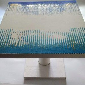 Table basse blanc, bleu turquoise, bleu marine, or