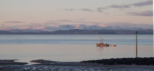 Fishing Boat On The Bay Before