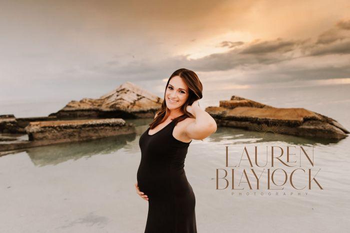 beach maternity photos of pregnant woman posing in tampa florida