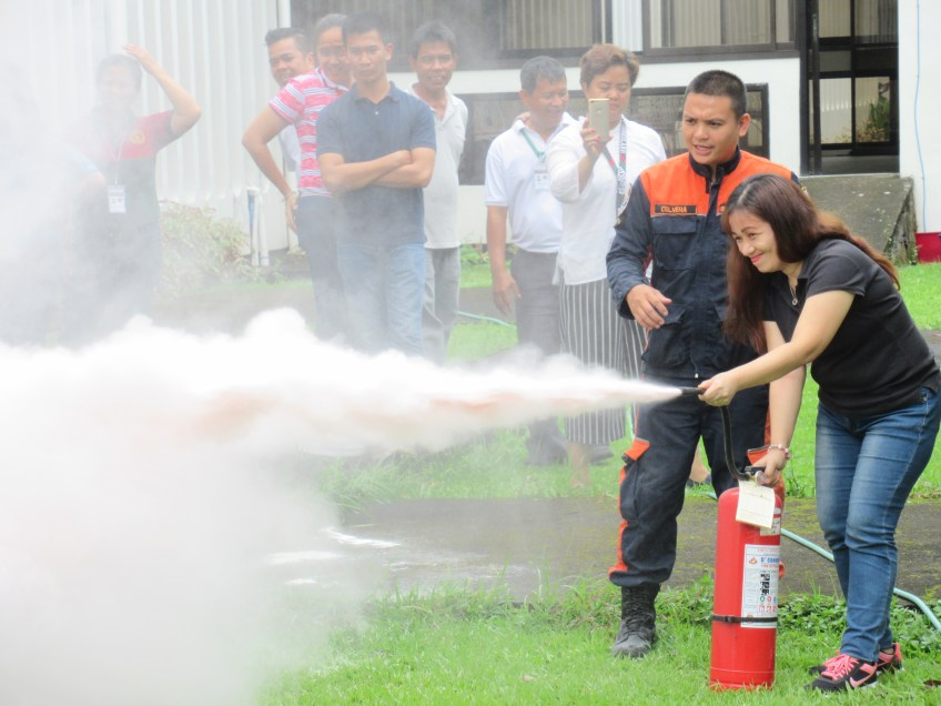 FO1 Ricardo Culvera, Jr. of BFP assists BAO staff in using the fire extinguisher. (Photo courtesy of BAO.)
