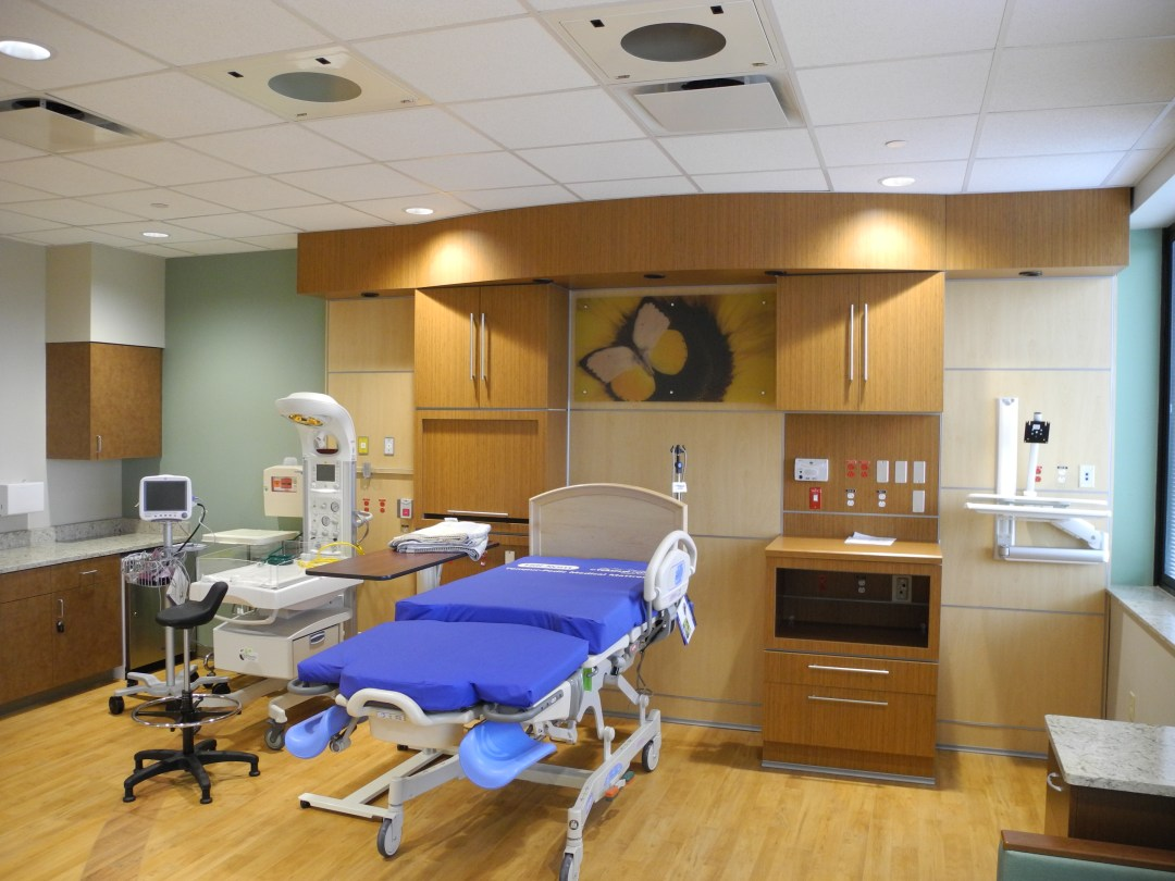 Medical room with cabinets, bed, and medical equipment