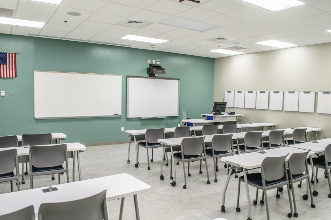 Classroom with white boards and desks