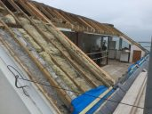 roof fully exposed ready for the three dormers to be built