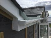 Fascia and Sofet detail tighing in with the flat fiber glass roof
