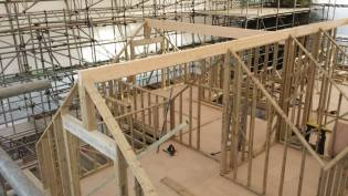 Gable ends erected and glue-lam beams lifted into place