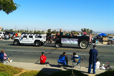 Parade watchers take in the floats and sights of the Hesperia Days Parade.