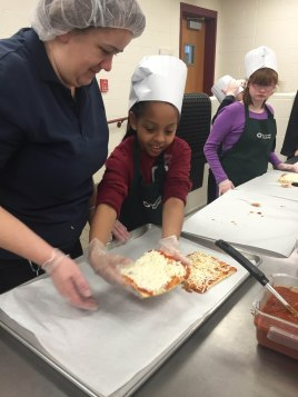 Students excited to put their pizzas in the oven!