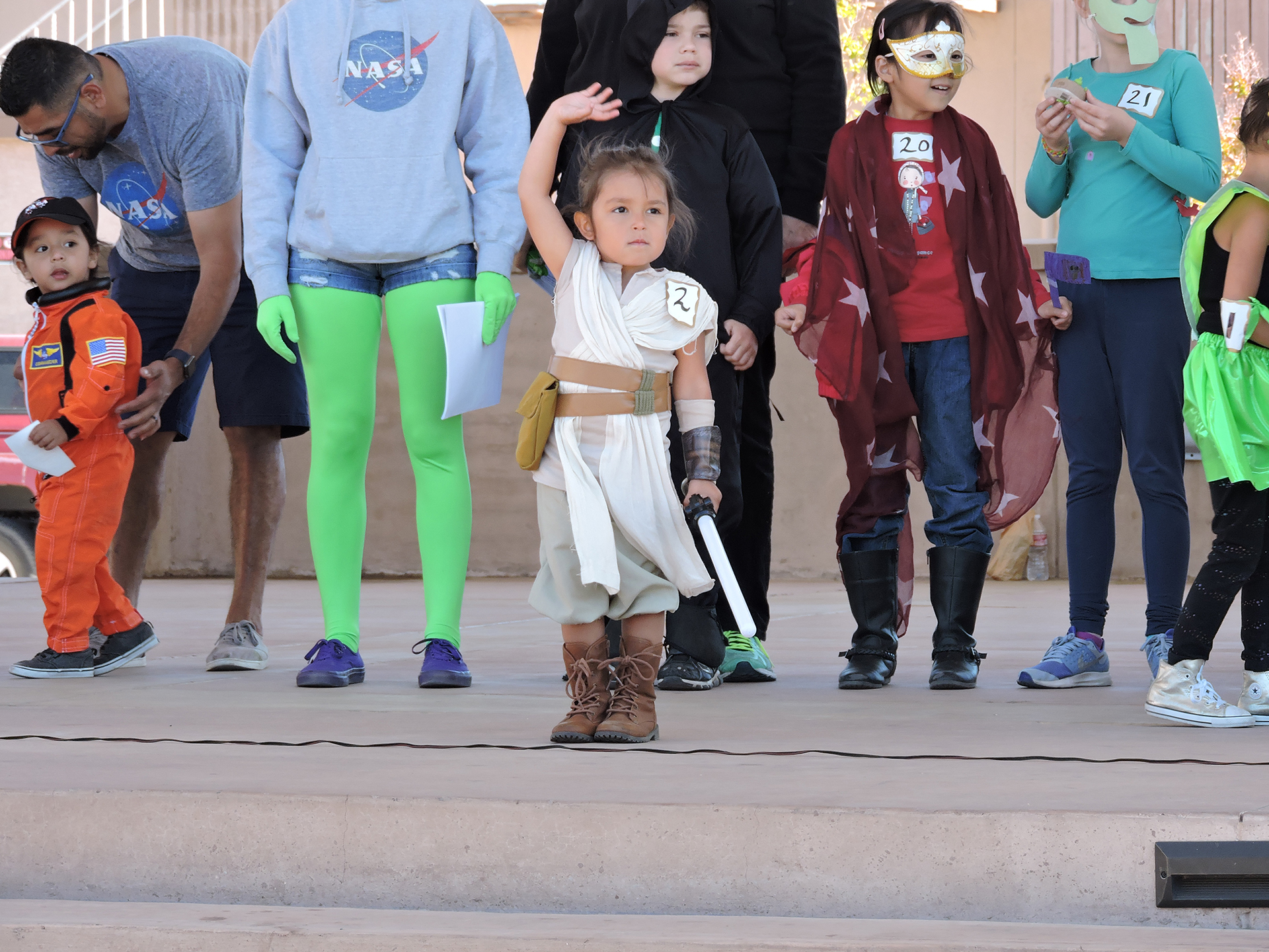 Kid attending Las Cruces Space Festival Space Walk dressed as Rey from Star Wars