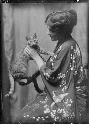 Warren, Gertrude, Miss, or Miss Jackman, with Buzzer the cat, portrait photograph