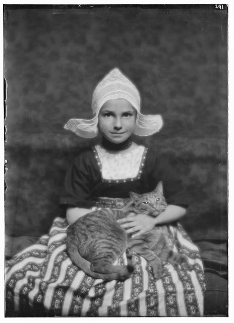 Silvester child with Buzzer the cat, portrait photograph
