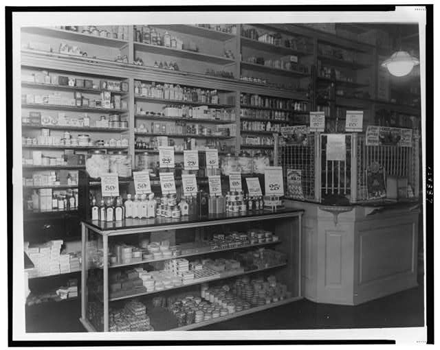 [Interior of People's Drug Store, No. 9, 31st and M Streets, Washington, D.C., with products in display cases and on shelves]