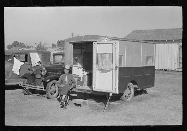 Former cowboy living in trailer home in midst of migrant camp, Weslaco, Texas. He has independent income and travels around the country