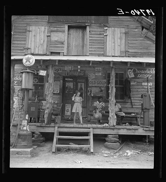 Daughter of white tobacco sharecropper at country store. Person County, North Carolina
