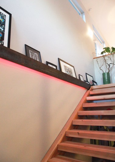 Dramatic lighting at the entry stair.