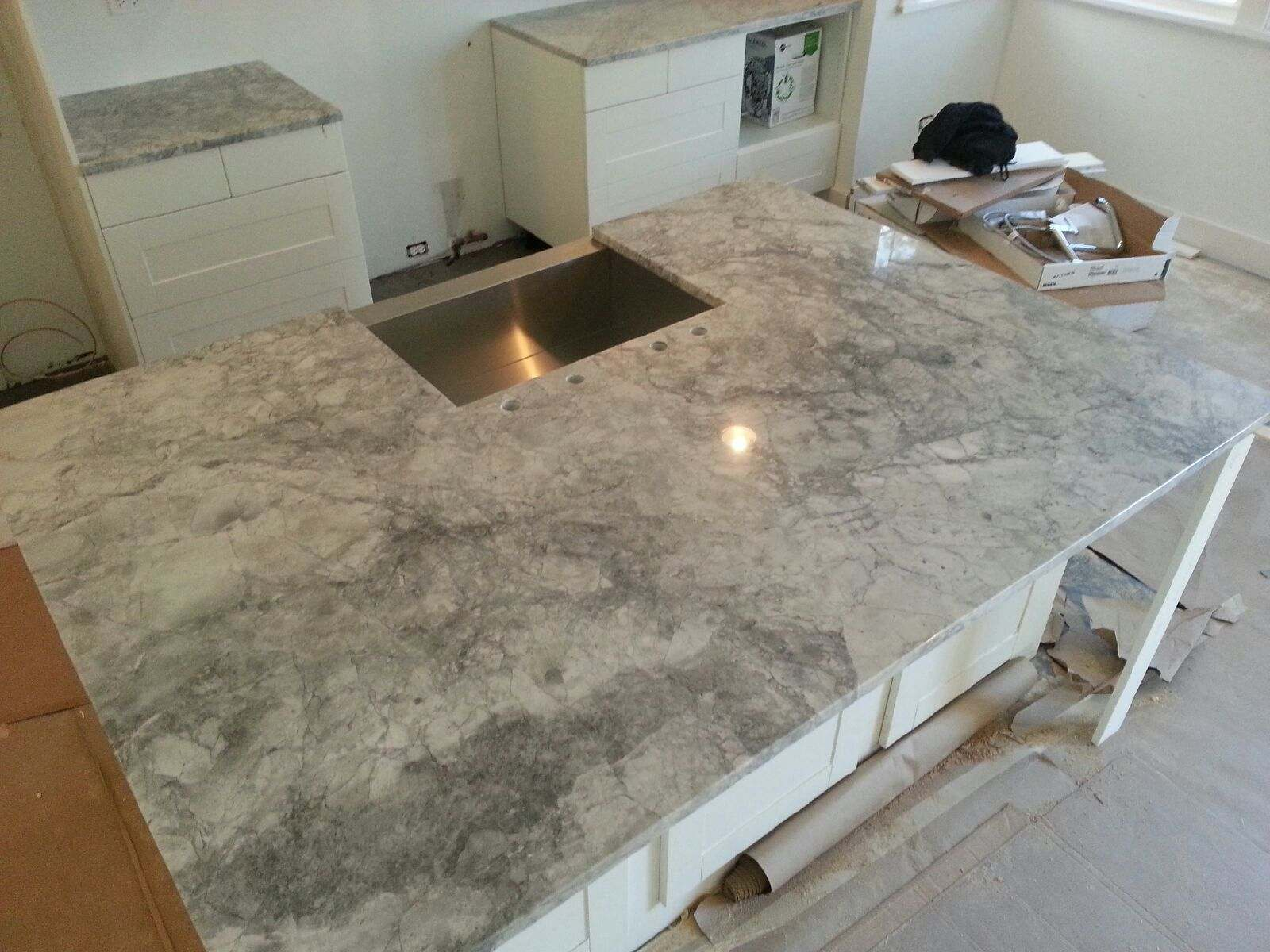 Installation Of The Super White Granite Countertops In Naperville IL.