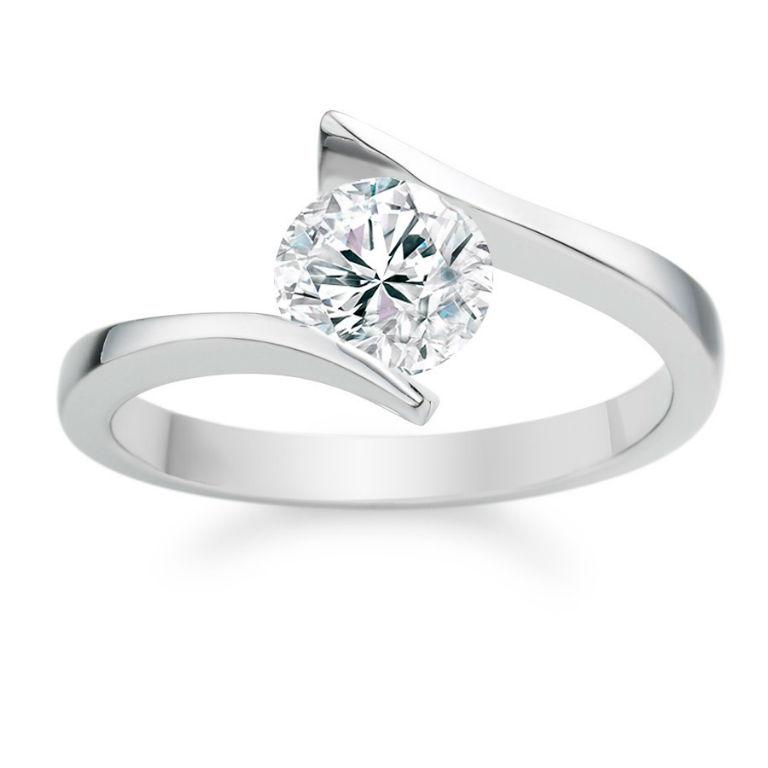 9 - Platinum engagement ring with round cut, 0.69 carat diamond