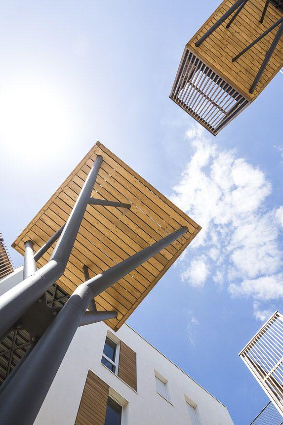 # 以社區交流為概念的陽台公寓:位於法國巴黎羅曼維爾郊區 12