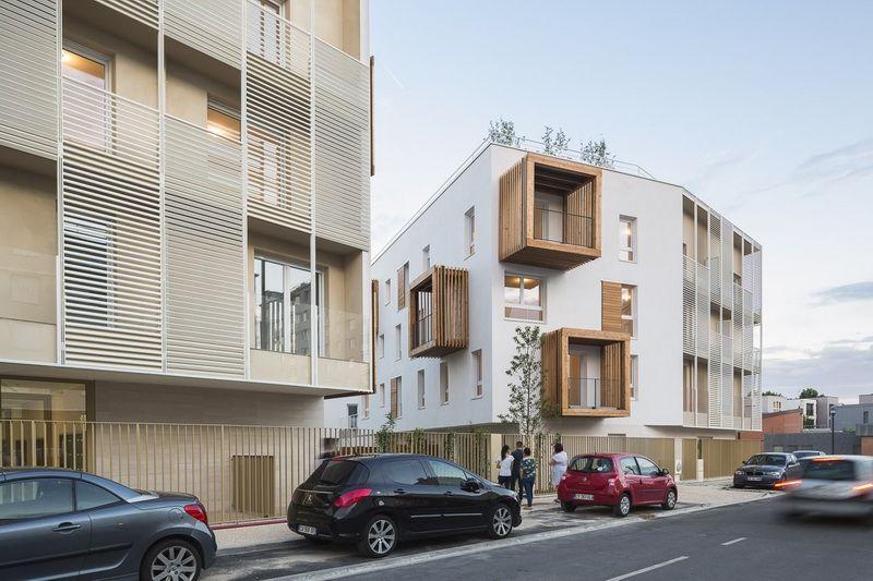 # 以社區交流為概念的陽台公寓:位於法國巴黎羅曼維爾郊區 9