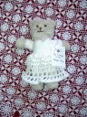 My mother knitted a bear for her, as she does for all her grandchildren. Usually they're in bright colors, but Carolyn's is in her white temple dress.