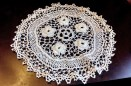 Irish lace doily with roses, clones knots and traditional edging
