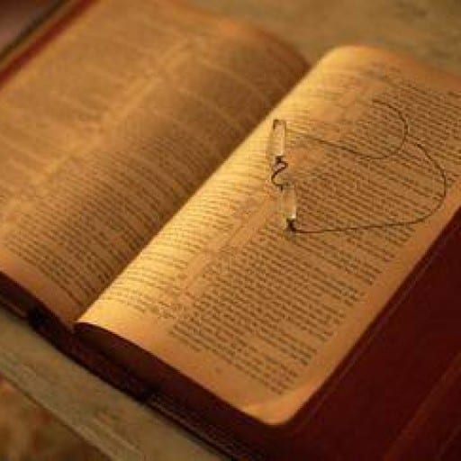 open scriptures with glasses resting on the pages