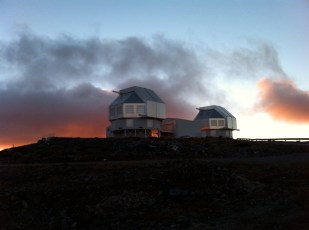 "The twin, ""regular"" Magellan Telescopes with dramatic cloud backdrop. That's Baade on the left and Clay on the right. Used 'em both. Love 'em both."