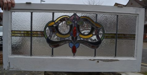 A1053b. SOLD. Rescued from a bungalow in Leigh-on-Sea, Essex, dated 1925. I recognise some styles of leaded lights to the English towns they are from. Originally every town would have had its own leaded light company supplying for the local area. Leigh-on-Sea and Southend are my favourite towns in England for sourcing salvaged glass. The dark greens used are very distinctive.
