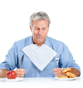 bigstock-A-hungry-man-making-the-hard-c-42760231