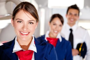bigstock-Air-hostess-with-the-airplane--30782459