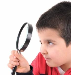 bigstock-Little-child-looking-through-a-19473143