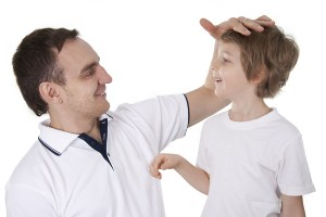 bigstock-Father-And-Son-Cheerfully-Talk-11604863