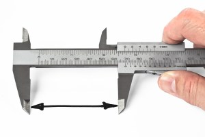 bigstock-Measurement-With-Caliper-44942719