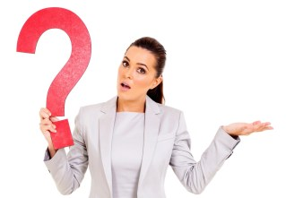 confused woman holding question mark on white background
