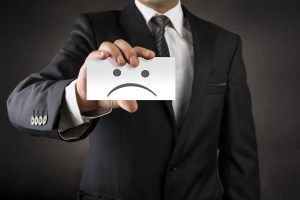 Businessman showing sad on business card