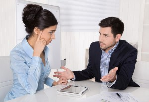 Conflict and problems on workplace: discussing boss and trainee.