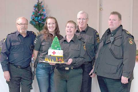 Members of the Emergency Response Team — from left, Terry Benson, Rikki Chobotuk, Laura Friesen, Brian Harrison and Tom Willms — pose with the custom cake designed by Amanda Bell.  (Photos courtesy of Gary Boehm/GDB Imaging Photography)