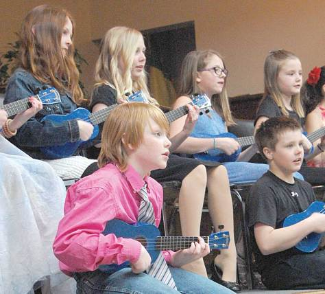 Grade 4 students from Davidson School perform on their ukuleles during the grand finale of the Central Saskatchewan Music Festival on Wednesday.