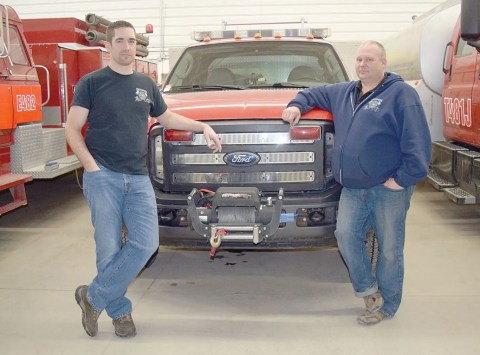 Deputy chief Don Willner and chief Clayton Schilling of the Davidson Volunteer Fire Department pose with the rapid rescue unit at the fire hall.