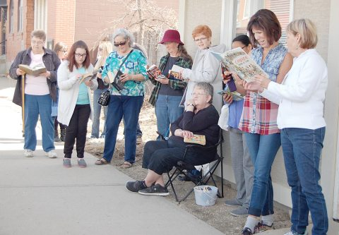 "Library supporters stand outside Arm River MLA Greg Brkich's office on April 7 for a ""Drop Everything and Read"" protest against cuts to provincial funding for Saskatchewan's regional libraries."