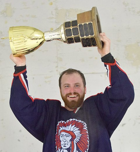 Craik Warriors captain Bert Watkins hoists the Wheatland Senior Hockey League championship trophy.
