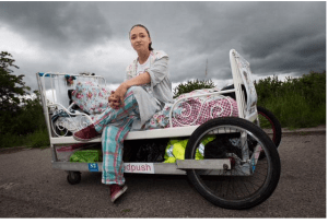 Rosie Mai is wearing red sneakers with her plaid PJs - #GreatBritishBedPush - what will she wear when this pair wears out?