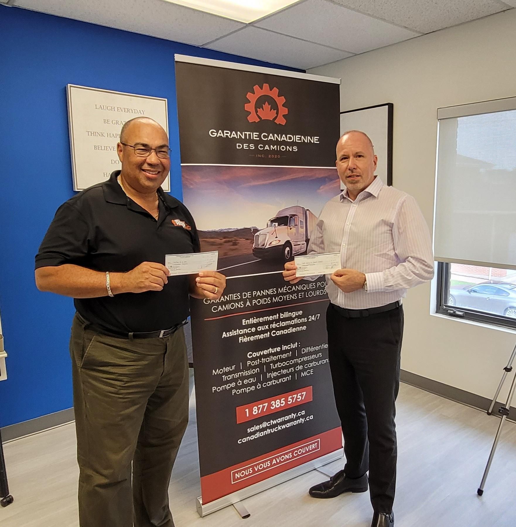 Paul and Bruce with cheque