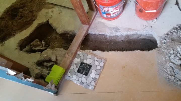 digging a shower drain