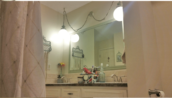 view of mirror from bath tub