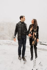 Burberry scarves in the winter in the snow engagement shoot by Susan Shek