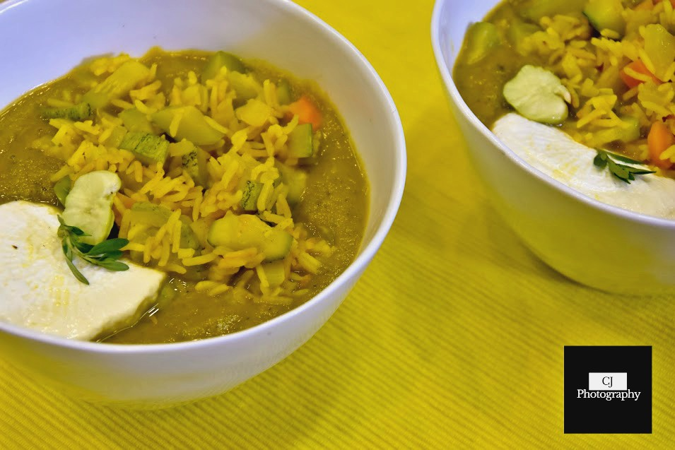 fresh herb soup with turmeric vegetable rice