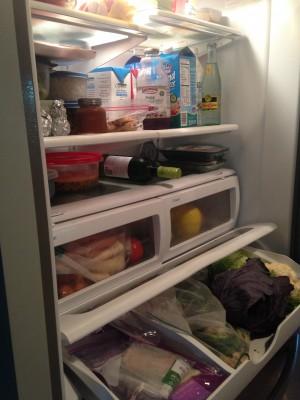 Inside of refrigerator showing shelves of food