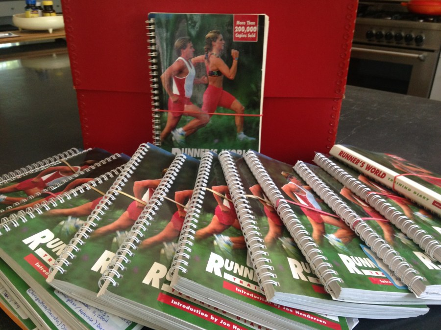 15 identical running logs from Runners World spread out