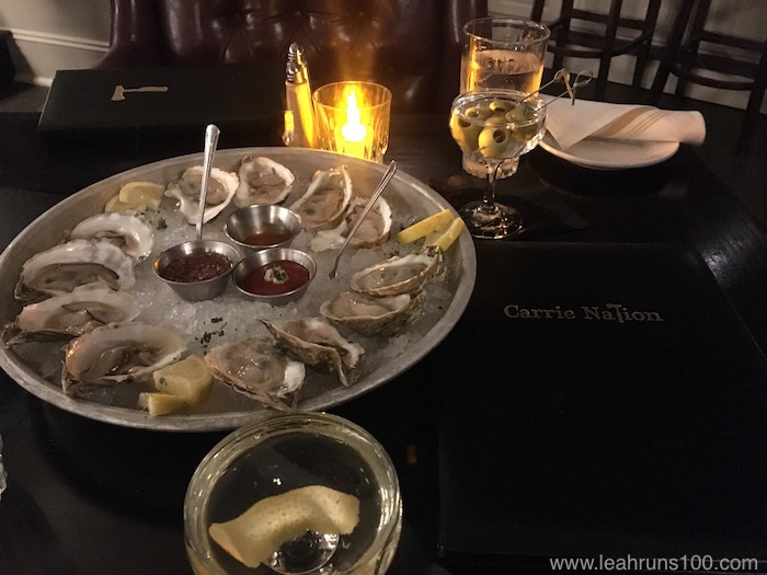 Raw oyster plate with cocktails at Boston's Carrie Nation bar and restaurant
