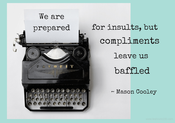 "typewriter with the words ""We are prepared for insults, but compliments leave us baffled"""